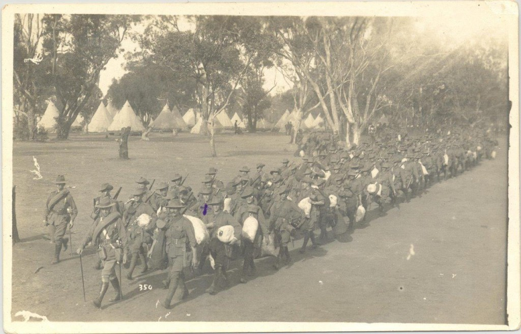 Postcard of 11th Battalion marching from Blackboy Hill before departure from Fremantle. Alf has marked a cross in the card to ensure that his sweetheart can locate him in the picture.