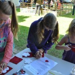 Three Girls Making Poppies